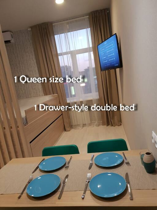 Living room with 1 Queen size bed and 1 Drawer-style double bed