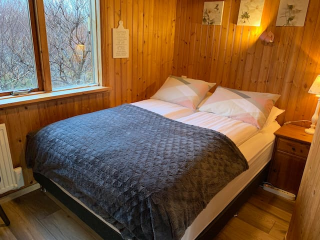Guest house. Bedroom 5 with high quality queen size bed.