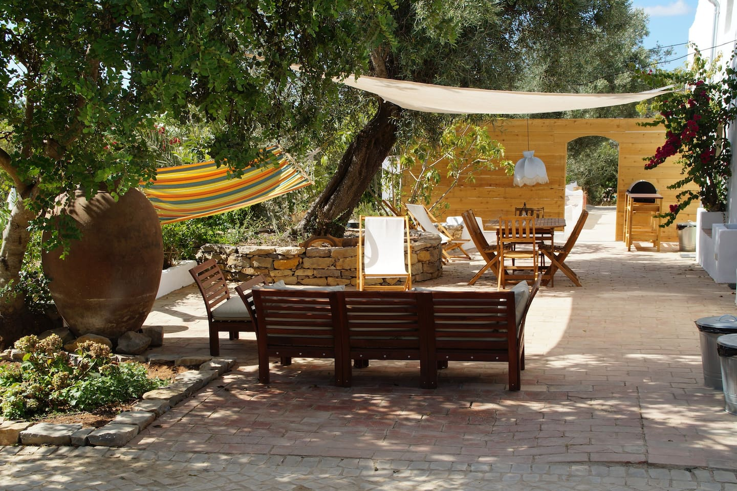Private terrace of Casa Estavel with hammock, loungeset, dining table, BBQ and outside shower.