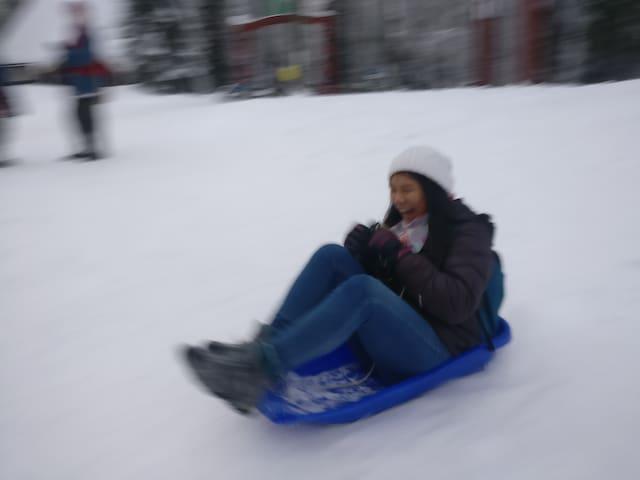 Downhill sledging.