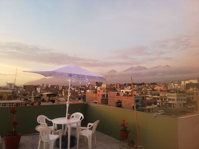 roof top views of the mountians and city sunsets