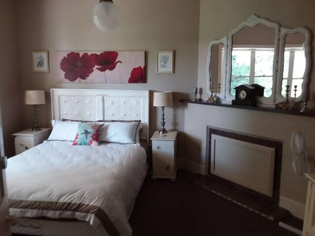 Queen bed with king doona.