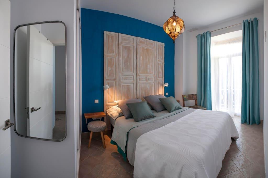 Master bedroom with small European balcony.