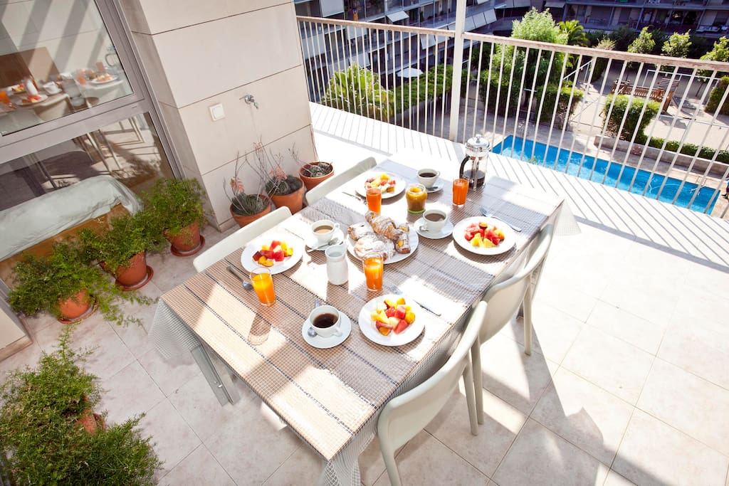 TERRACE: private terrace overlooking the pool area and gardens -