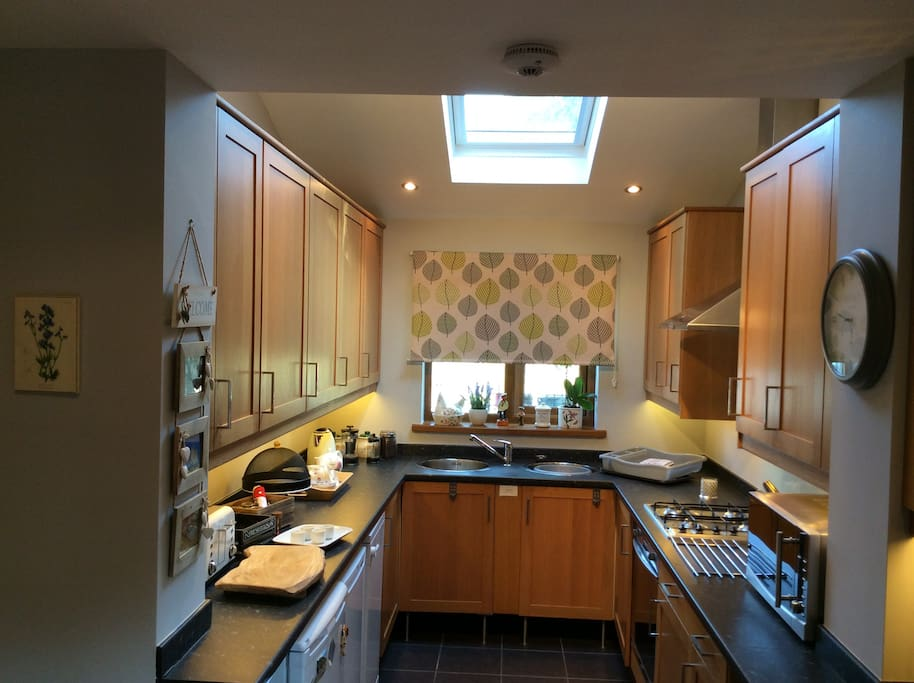 A well equipped kitchen with all undercounter white goods and breakfast area