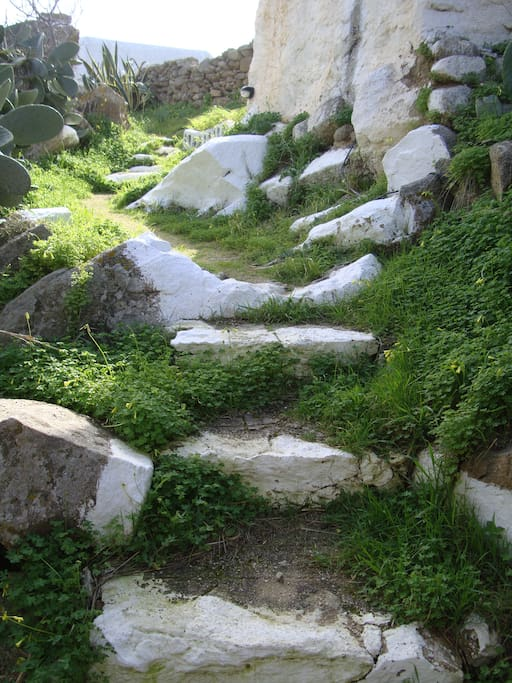 Stone path leading to home (lit at night)