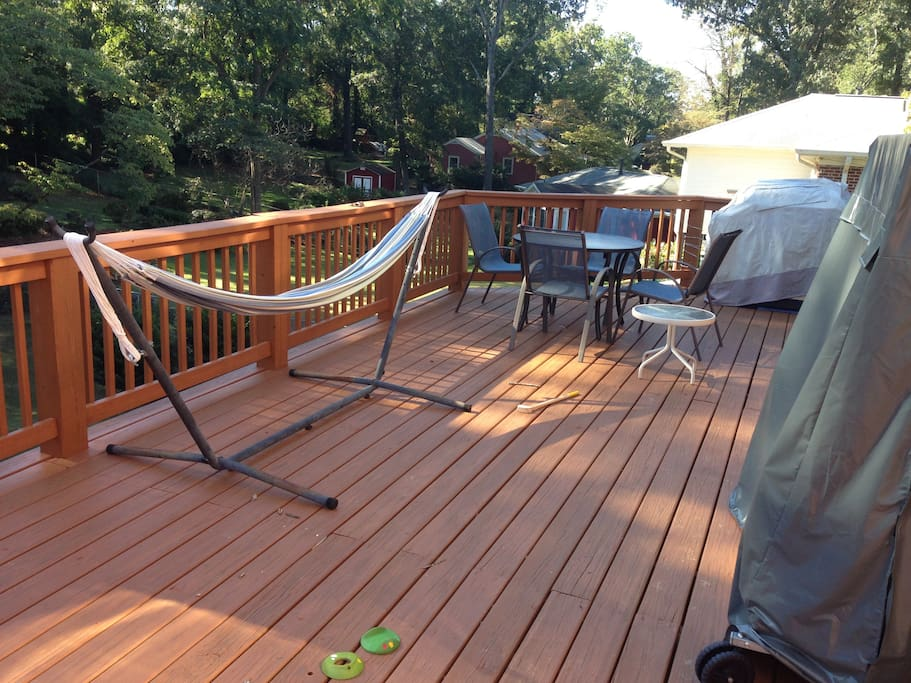 Deck with gas grill and ping pong table.
