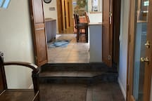 Entryway with two steps to enter main house