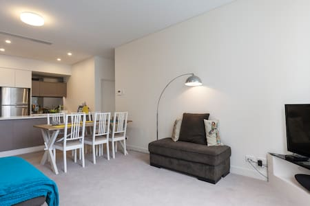 Large room to let with your own bathroom in a luxury ground floor apartment.  Your host will be occupying the other bedroom.  Apartment is a short 10-15 in bus ride to Central Station.