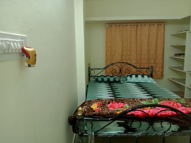 Master Bedroom with a Double cot and attached bathroom.