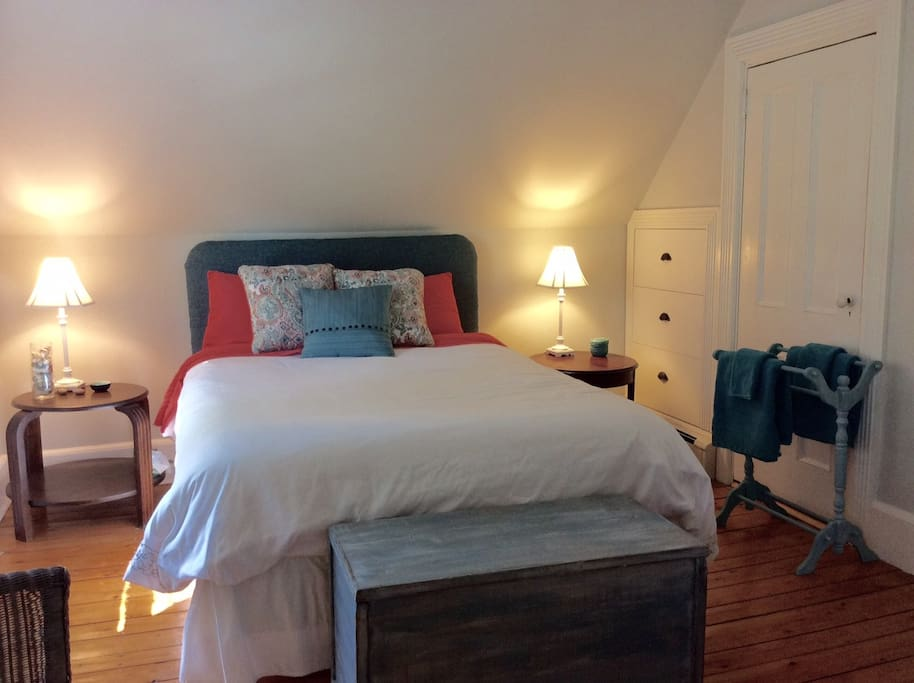 The Green Room has a comfortable Queen bed and ample hanging and bureau space.