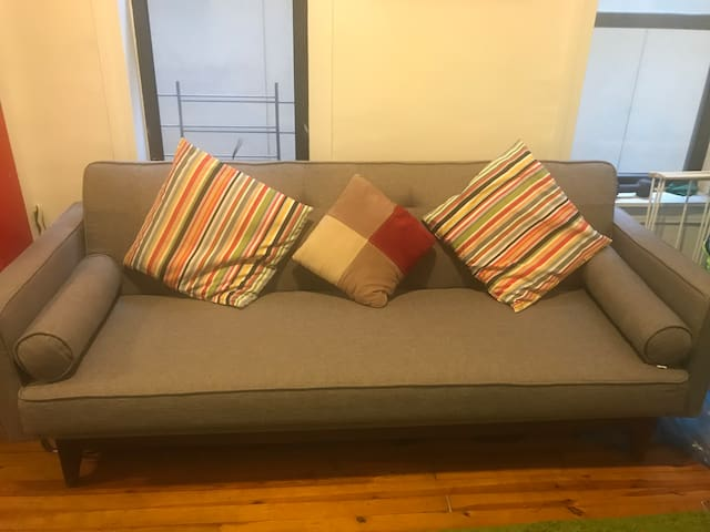 Comfy Couch in a nice and safe apt!!