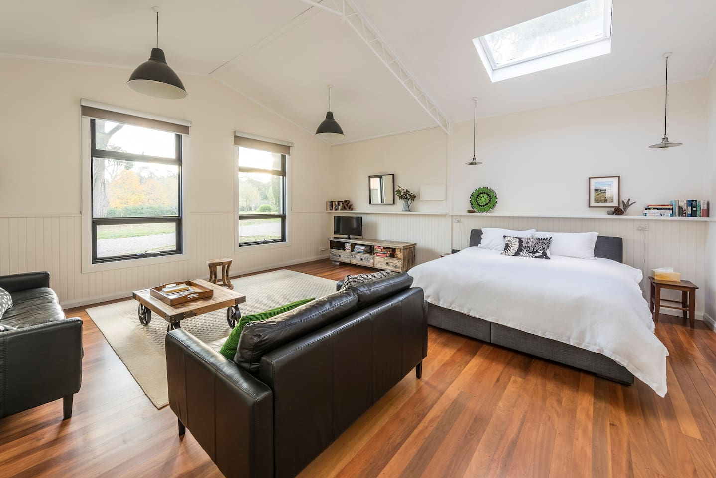 The Studio room contains a KING bed with an overhead skylight for evening stargazing. Looking out to our 30 orchard trees. Reverse cycle air con.