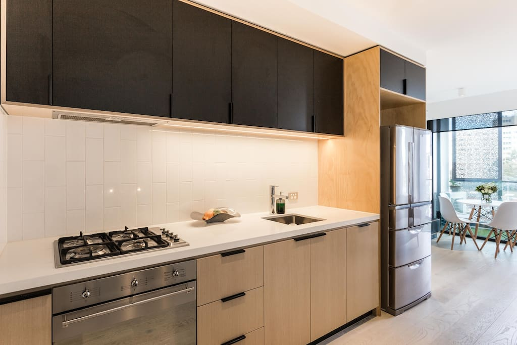 Open kitchen equiped with SMEG gas appliance. Fridge is loaded with spring water for you to enjoy.