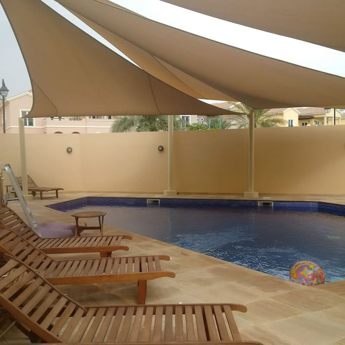 Private pool with sun shade and sunbathing area (exposed to sun), also has outdoor changing rooms, towels and facilities
