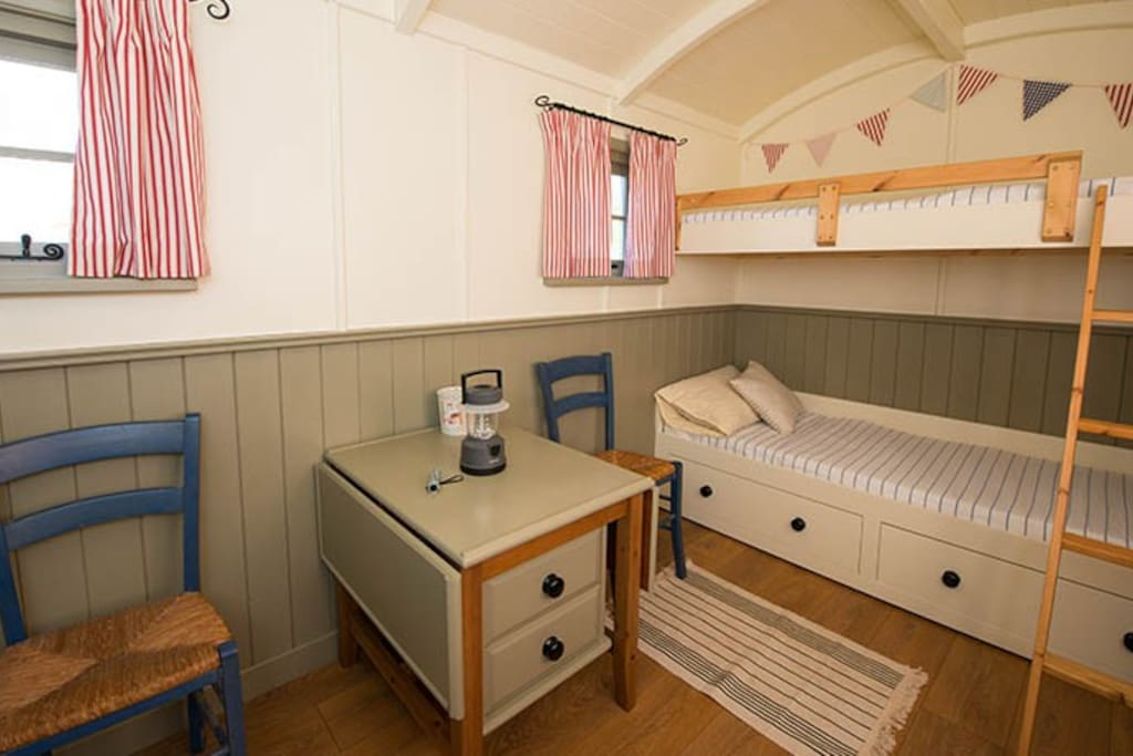 Kids room with X2 bunks, one is a pull out to double
