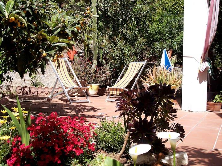 Apartment with  veranda,garden,wi-fi,air-con/heat.