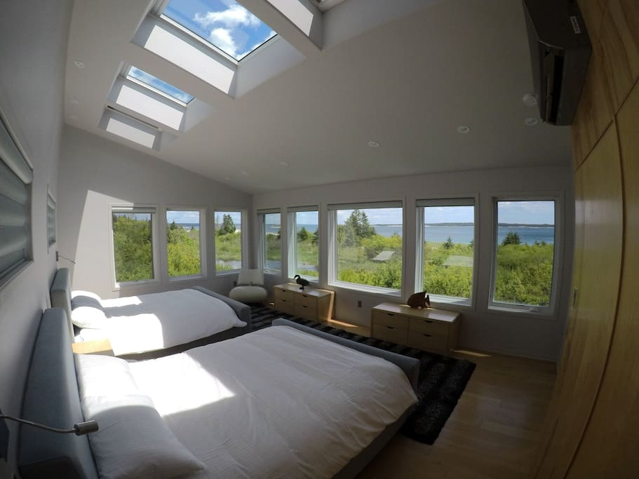 First bedroom with panoramic ocean view and big skylights.