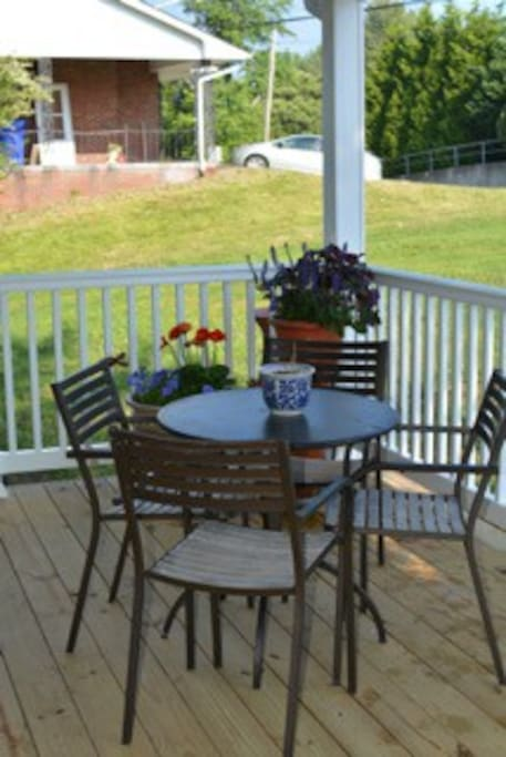 Covered porch offers a welcoming place to have a drink, work or visit with friends.