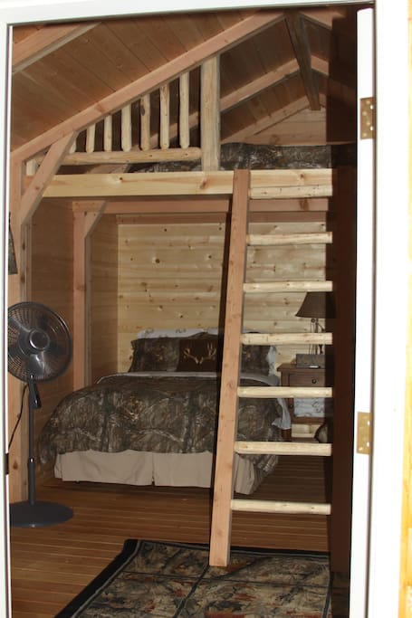 Cabin offers two double beds below and a Queen  in the loft.