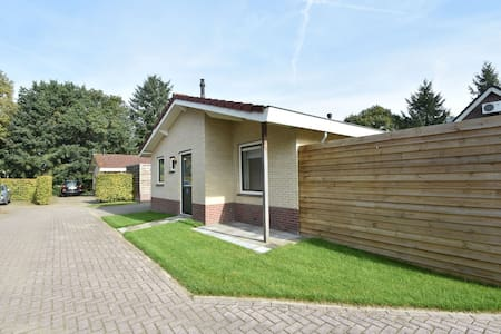 Modern holiday home with a luxury walk-in shower and enclosed private garden in Putten
