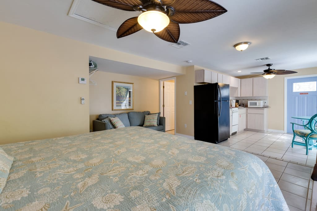 Studio Cottage has a full kitchen, king bed, sofa sleeper, free wifi, and parking for one car.