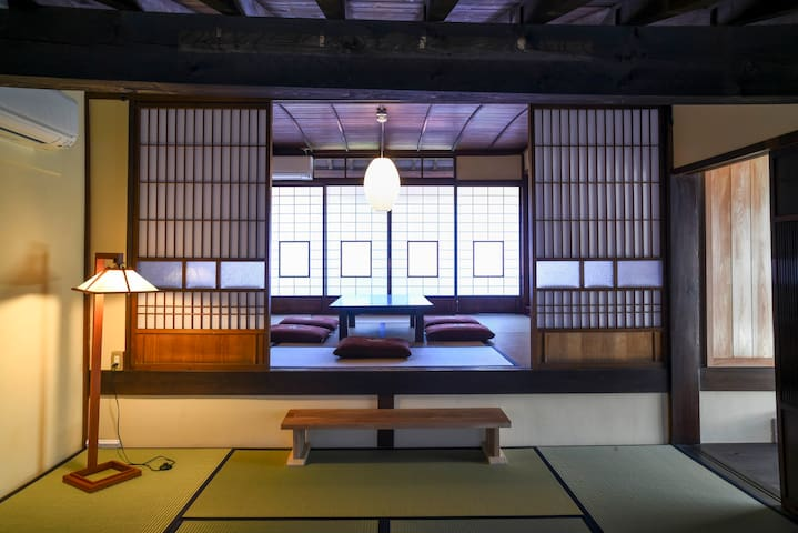 Two Bed Rooms with Japanese Traditional Style in 2nd Floor. Two-Six Futon mattress on Tatami Flooring is ideal for couple, family, and group. Up to Eight people can stay.