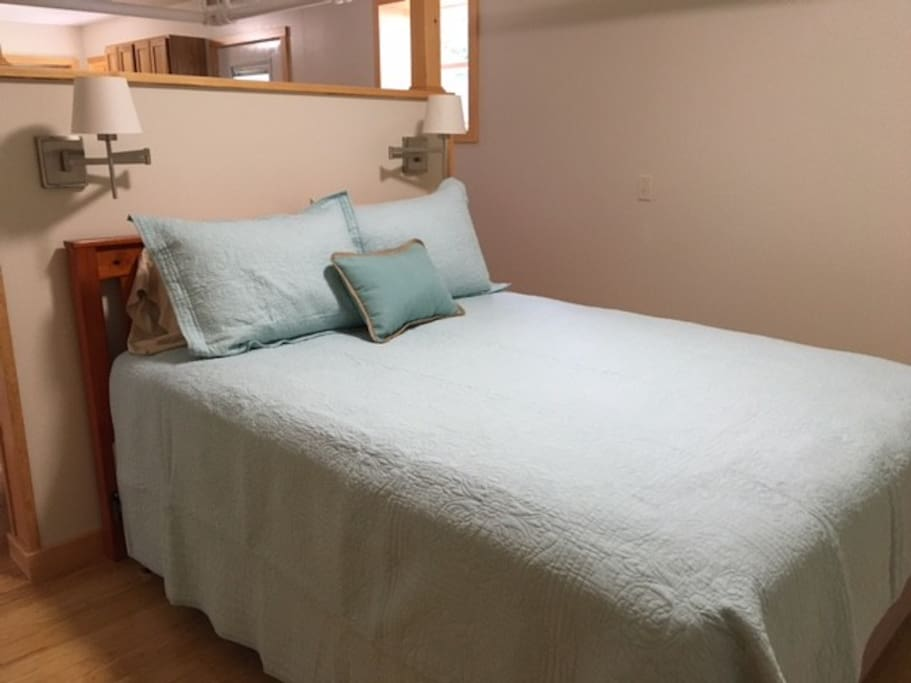The bedroom area, while not a separate room, is quiet private due to the 3/4 wall that separates it from the living space.