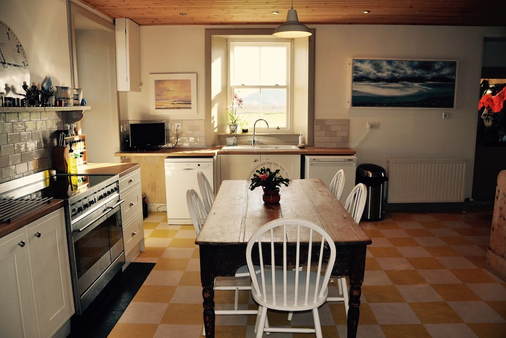 Kitchen. Table will seat up to 8 people. Large range-style induction cooker. Dishwasher, fridge, freezer and fridge/freezer in walk-in larder. Magi-mix food processor, stick blender, breadmaker, slow cooker, I've-cream machine, toaster, kettle, microwave and everything else you would need.