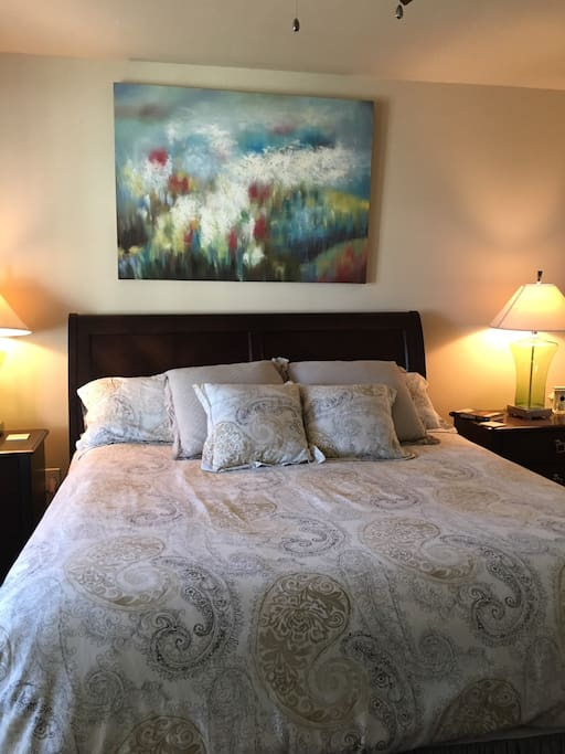 Master bed room with King bed, door to balcony and large en suite bathroom