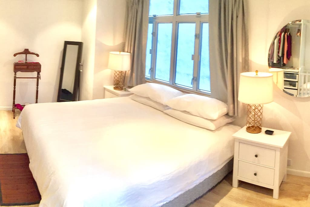 Master bedroom, king sized bed and double night stands