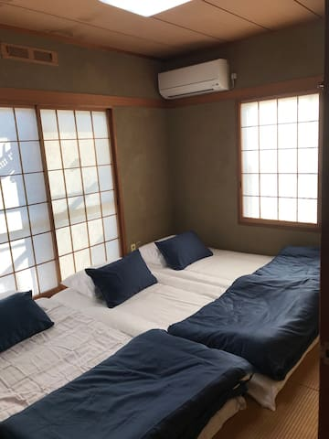 Traditional Japanese Tatami Room .,can accomodate 3  adults and 1 child.