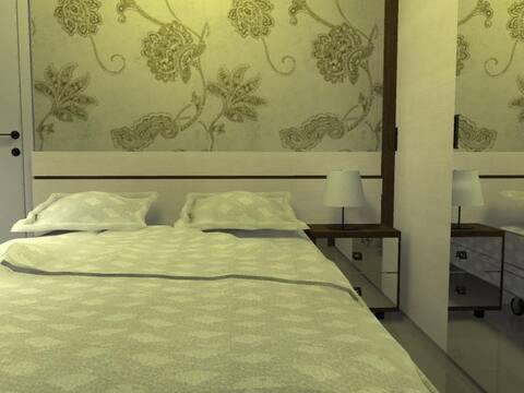 Um quarto aconchegante e barato.