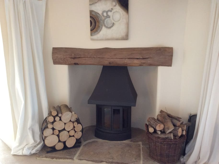 Cosy log fire in guests sitting room for those cosy nights in...