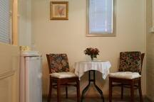 Queen Victoria Suite Sitting room with cafe style setting, cutlery, microwave, toaster, fridge etc