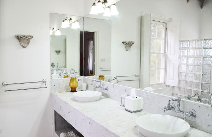 Marble detailed bathroom with double sinks