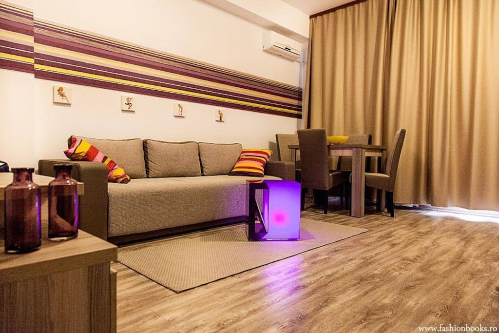 The living room is furnished and has modern facilities such as sofa in the living room, LCD TV , air conditioning, dining room.