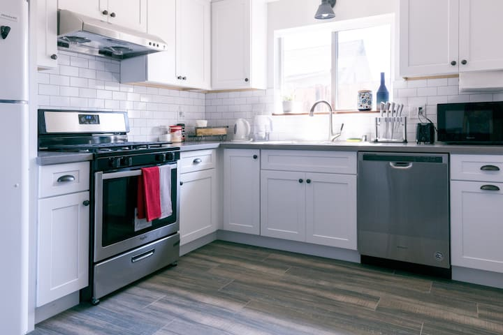 A full kitchen with everything you need to whip up a quick meal or slow cook for the entire family. Dishwasher makes clean up easy & breezy.