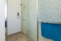 We have recently renovated our bathroom and love our new tiles.  We hope you do too!   The water pressure here is great, perfect for washing off sandy bodies!