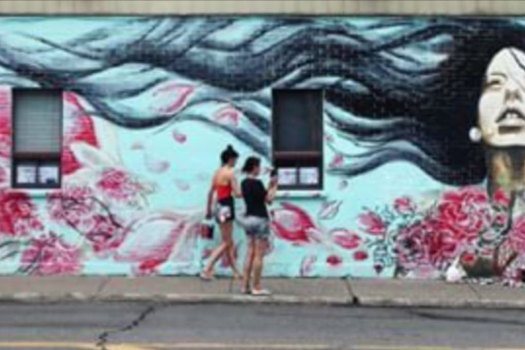There are a number of great murals in St. Henri and this one, a few blocks away on the way to the metro, is our favorite!