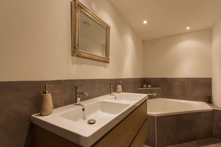 Bathroom with very big 2 person bath