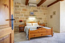 Large master bedroom with views of the citadel and an ensuite walk-in shower