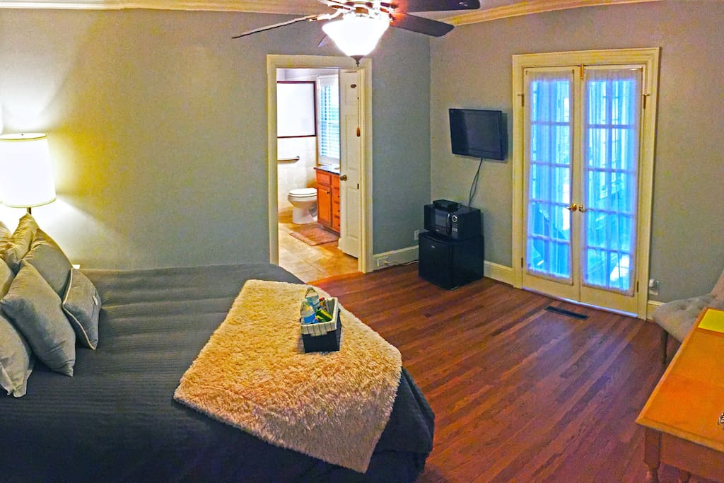 Picture of your private suite entrance, TV, Bathroom, and walk-in closet.