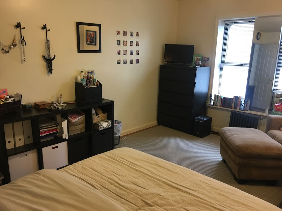 Smart TV in corner. Dresser drawers will be fully cleared for your use. Shelves will be partially cleared for your use.
