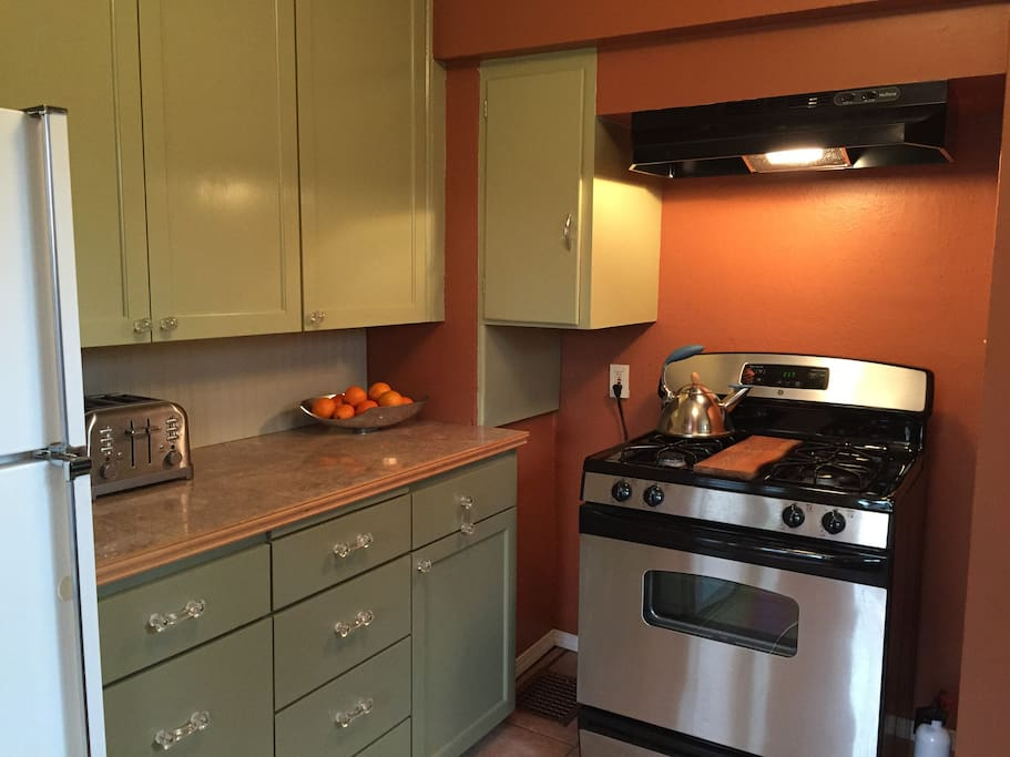 Well- stocked kitchen with utensils, cookware, refrigerator, gas stove, toaster & coffee maker