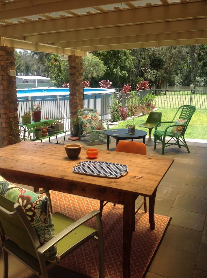 Large undercover patio with dining area and relaxing comfy chairs