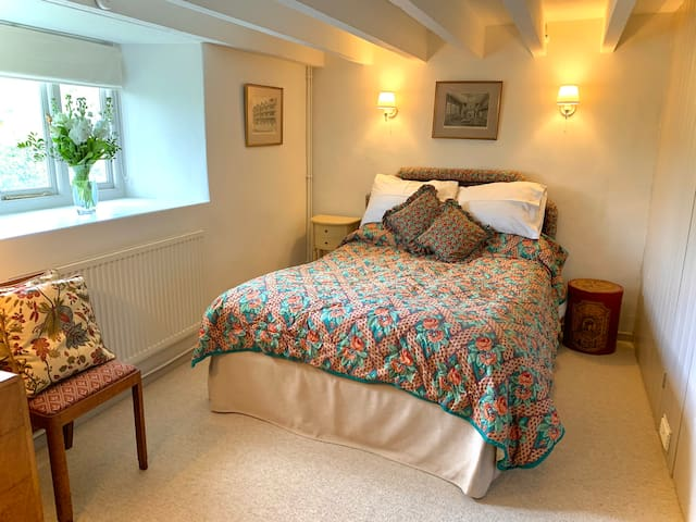 Double bed in lower bedroom, with double wardrobe and dressing table