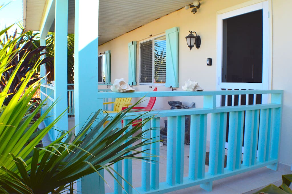Front Patio relax Island-Style at Poinciana Place