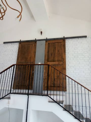Entrance to the bedrooms through barn doors