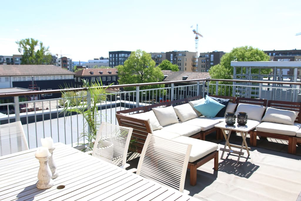 Private roof top terrace with lounge and dining area